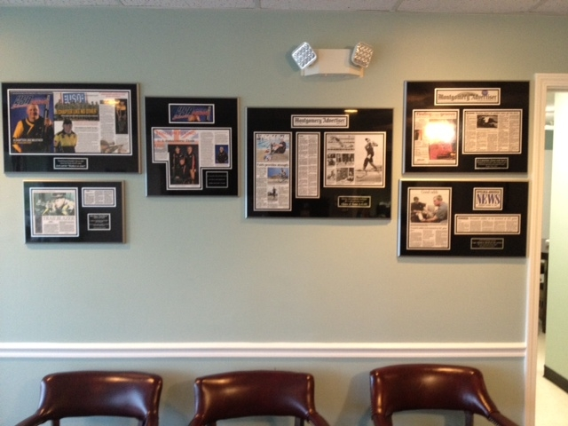 renovate wall space with framed newspaper magazine articles