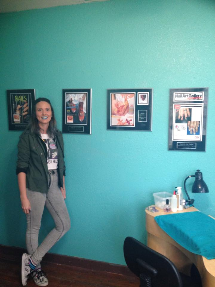 One of our happy customers, Liz Tackit, and her plaques on display in her salon!